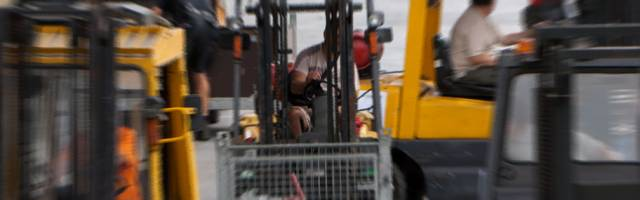 Busy forklifts on worksite