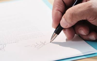 Signing a Wills and Probate document